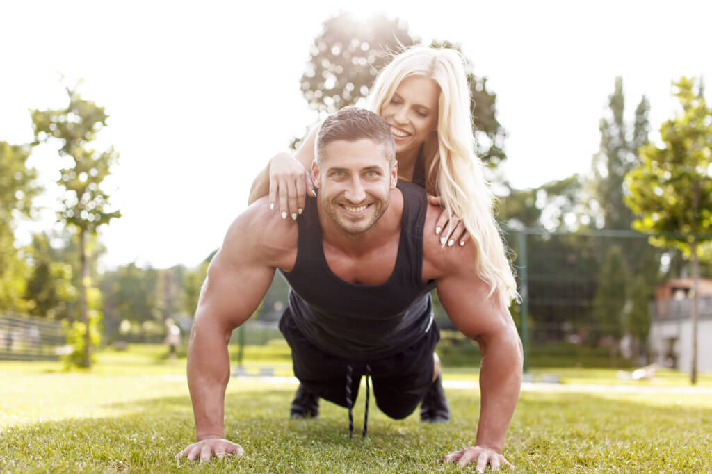 Couple enjoy working-out together to lose weight